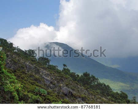 cloudy scenery showing the Mount Gahinga in Uganda (Africa)