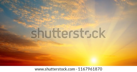 Cloudy sky and bright sunrise over the horizon. Wide photo . #1167961870
