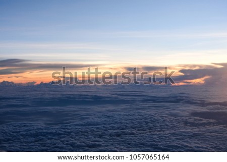 cloudy sky and sunset background top view from airplane window #1057065164