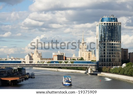 Cloudy sky at Moscow. Beautiful look from third transport ring at modern buildings and foot bridge over Moscow river.