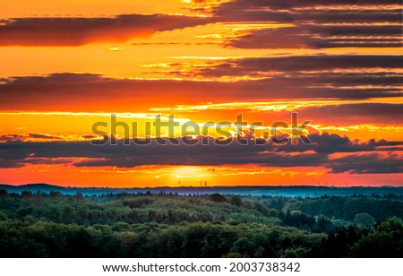 Cloudy sky at sunset landscape. Sunset cloudy sky. Sunset horizon landscape. Sunset sky clouds