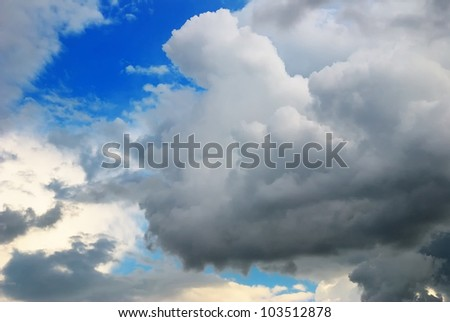 Cloudy sky full of deep grey thunder clouds on the sunset