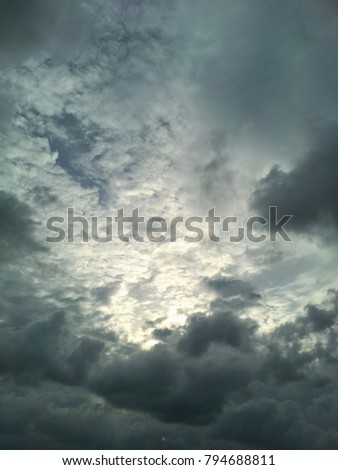Cloudy sky. Light in the dark and dramatic storm clouds. Beautiful storm sky with clouds. Cloudy sky at beach