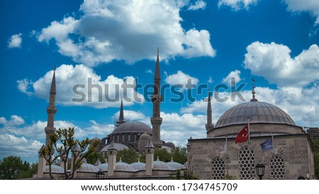 Cloudy sky over Blue Mosque Istanbul Turkey, Waving flag of Turkey, Mosque Minarets, Sultanahmet Mosque Minarets, Blue Mosque Minarets, Selective focus shallow depth of field