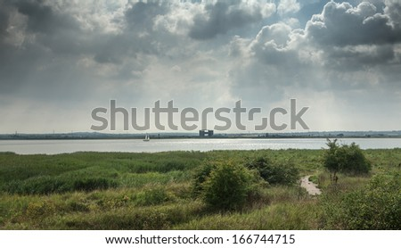 Cloudy sky over the river Thames in Purfleet, Grays, Essex
