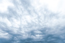 Cloudy sky. Stormy dark sky. Dark storm clouds in the evening spring sky