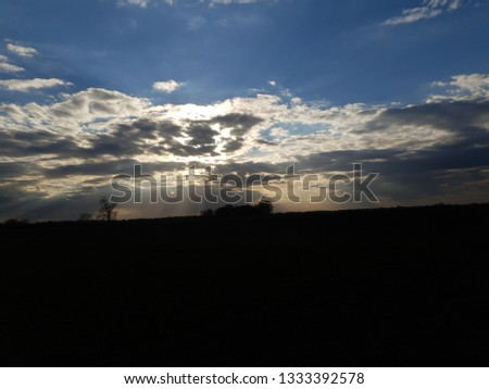 Cloudy sky with sun inside