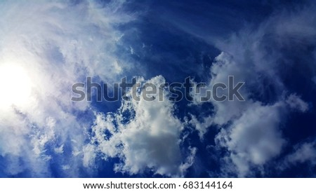 Cloudy sky with sunshine.  #683144164