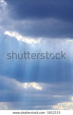 Cloudy stormy sky with sun ray breaking through
