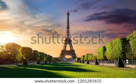 Cloudy sunrise and Eiffel Tower on Chaps de Mars in Paris, France Stock photo ©
