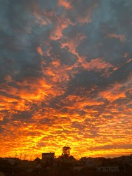 Cloudy sunrise during the California fires with sky of yellow, pink, orange and grey