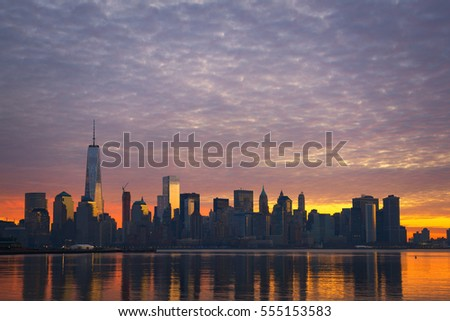 Cloudy Sunrise of Manhattan from Jersey City  #555153583