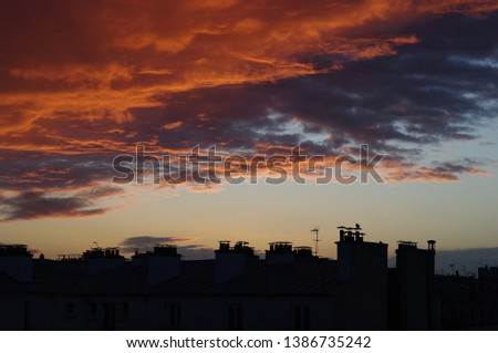 Cloudy sunset on Eastern Paris #1386735242