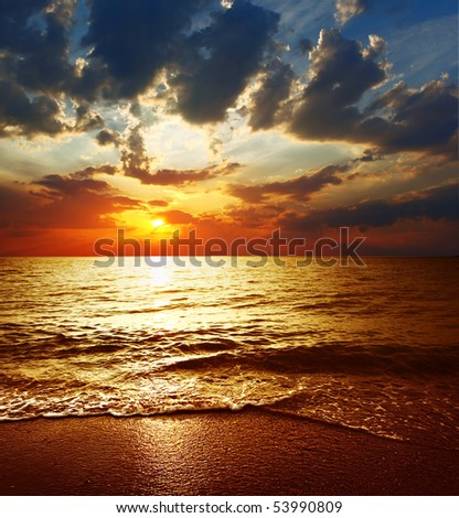 Cloudy sunset over sea - stock photo