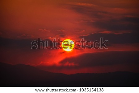 Cloudy sunset over the mountains #1035154138