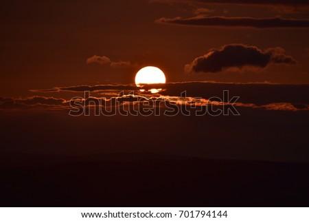 Cloudy sunset sun #701794144