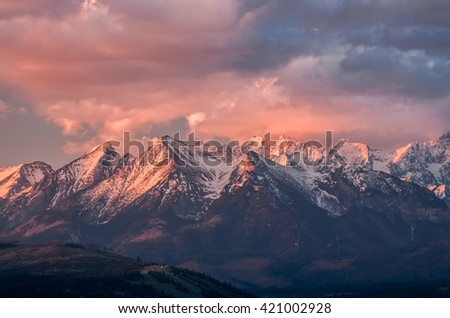 Cloudy Tatra mountains in the beautiful morning, covered with snow - Shutterstock ID 421002928