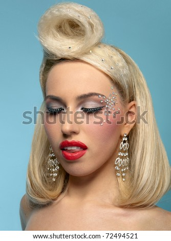 Clouse-up portrait of beautiful blond woman with fashion make up and hairstyle, eyes closed