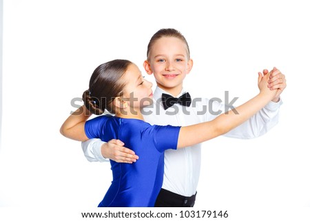 Clouseup portrait of young ballroom dancers in formal costumes posing. Isolated on white background