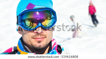 Clouseup portrait of young man with ski goggles in the Zillertal Arena, Austria
