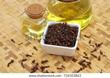 clove oil with clove #726503863