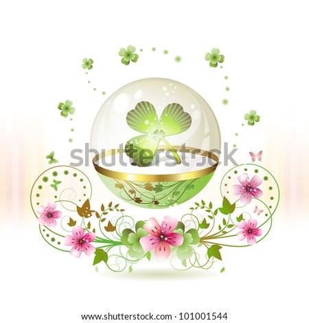Clover in glass globe with flowers and butterflies for St. Patrick's Day