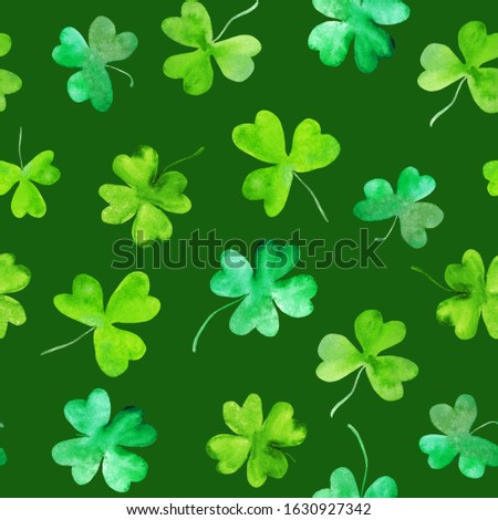 Clover leaves seamless pattern. Trefoils and four leaves plants watercolor texture. St Patrick day wallpaper on green repeated background