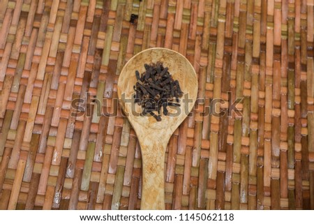 Cloves. Cloves is isolated on a wooden background. #1145062118
