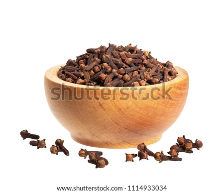 Cloves in wooden bowl isolated on white. Whole cloves #1114933034
