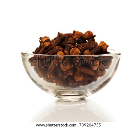cloves spice on a white background. Cloves - aromatic flower buds of a tree in the family Myrtaceae, Syzygium aromaticum.  #739204735