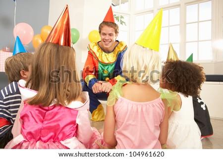 Clown entertaining children at party
