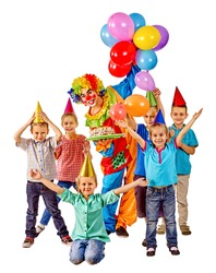 Clown holding cake and balloons on birthday with group children. Isolated.