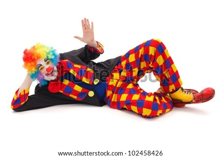 Clown laying on floor and waving with hand