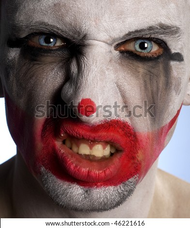 Clown looking very scary and angry in his crazy mood