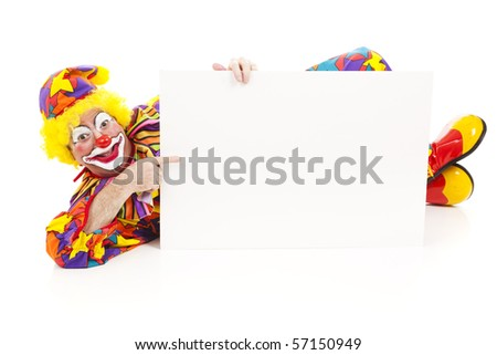 Clown lying on the ground holding a blank white sign.  Full body isolated on white.