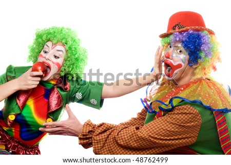 Clowns are fighting for an apple. Isolated