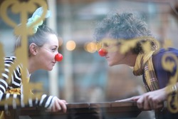 Clowns facing each other; street theater concept
