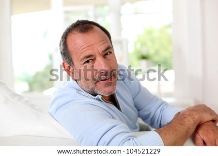 Clsoeup of handsome senior man relaxing in couch
