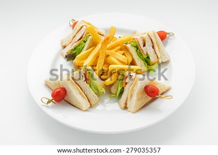 Club sandvich on a white plate isolated on white