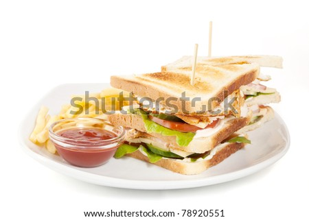 club sandwich with fries and sauce on white plate isolated on white background