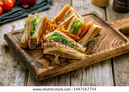 club sandwich with ham on the board
