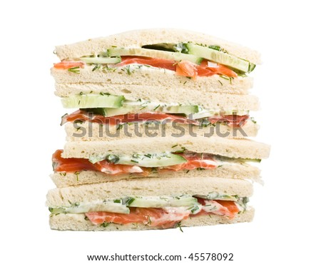 club  sandwiches with salmon and cucumbers on white bread