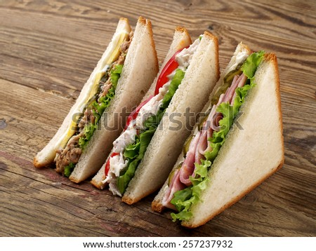 Club sandwiches with tuna, ham and chicken, selective focus