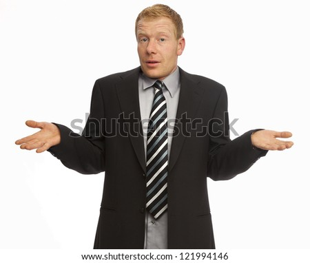 Clueless businessman posing against a white background