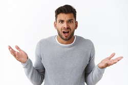 Clueless disappointed angry male client shocked with bad service, spread hands sideways in dismay and distressed, arguing looking questioned and frustrated, complain or condone someone
