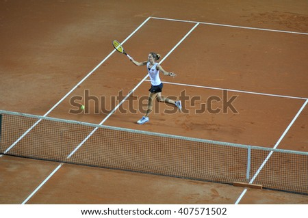 CLUJ-NAPOCA, ROMANIA - APRIL 7, 2016: Germany plays Romania during a Fed Cup Women double tennis match in the World Cup Play-Offs  #407571502