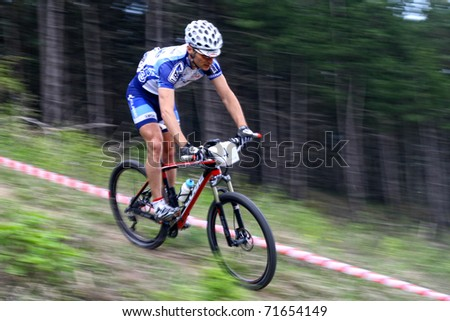 "CLUJ-NAPOCA, ROMANIA - APRIL 24: unknown Romanian biker in action at ""Maros Bike Downhill Marathon 2010"" on APRIL 24, 2010 ,Cluj-Napoca, Romania"
