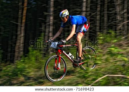 "CLUJ-NAPOCA, ROMANIA - APRIL 24: unknown Romanian biker in action at ""Maros Bike Downhill Marathon 2010"" on April 24, 2010 ,Cluj-Napoca, Romania - stock photo"