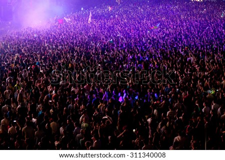 CLUJ-NAPOCA, ROMANIA - AUGUST 3, 2015: Crowd having fun during a live concert at Untold Festival in the European Youth Capital city #311340008