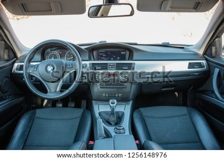 Cluj Napoca/Romania - December 01, 2018. Inside modern luxurious car view - panoramic double sunroof, leather seats, big navigation display dashboard, clean close-up detailed photo. #1256148976